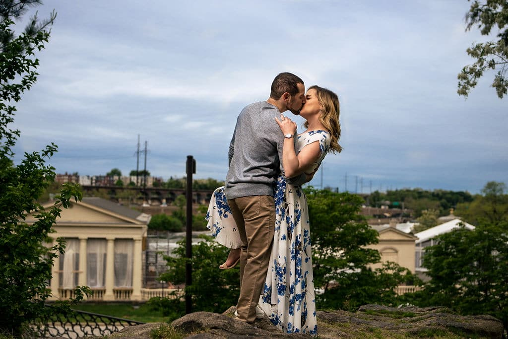 Couple on top of the hill kissing Philadelphia Engagement Session Shot by John Ryan