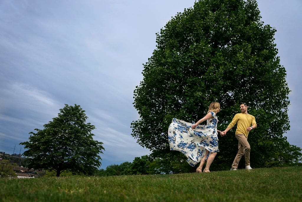 Engaged couple having fun in park Philadelphia Engagement Session Shot by John Ryan