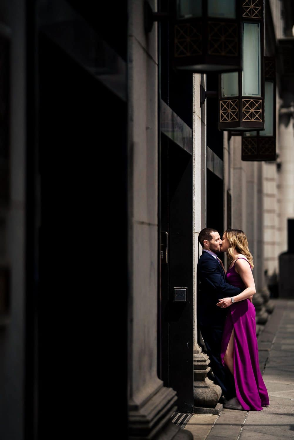 Engaged couple dessed up downtown Philly engagement shoot Shot by John Ryan