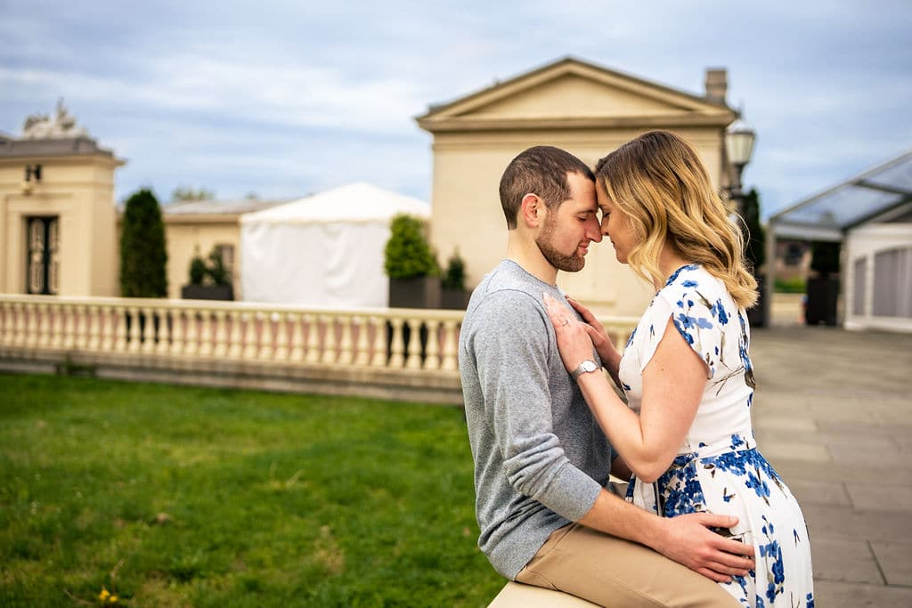 Couple head to head embracing at Philly Museum of Art Philadelphia Engagement Session Shot by John Ryan