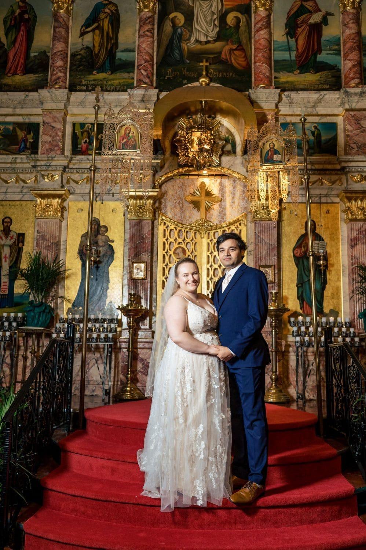 Beautiful couple standing in front of Greek Church hiladelphia Greek Orthodox Church Wedding Photographer at the Greek Church Shot By John Ryan