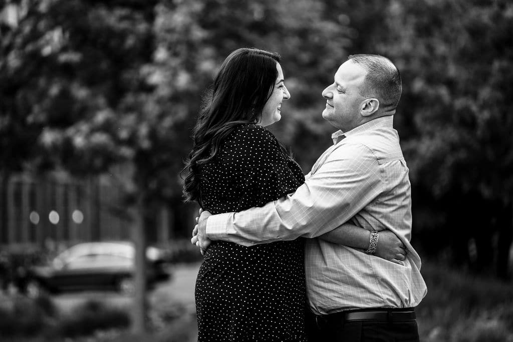 Black and white photo of engaged couple in love Philadelphia Navy Yard Engagement Session Shot by John Ryan