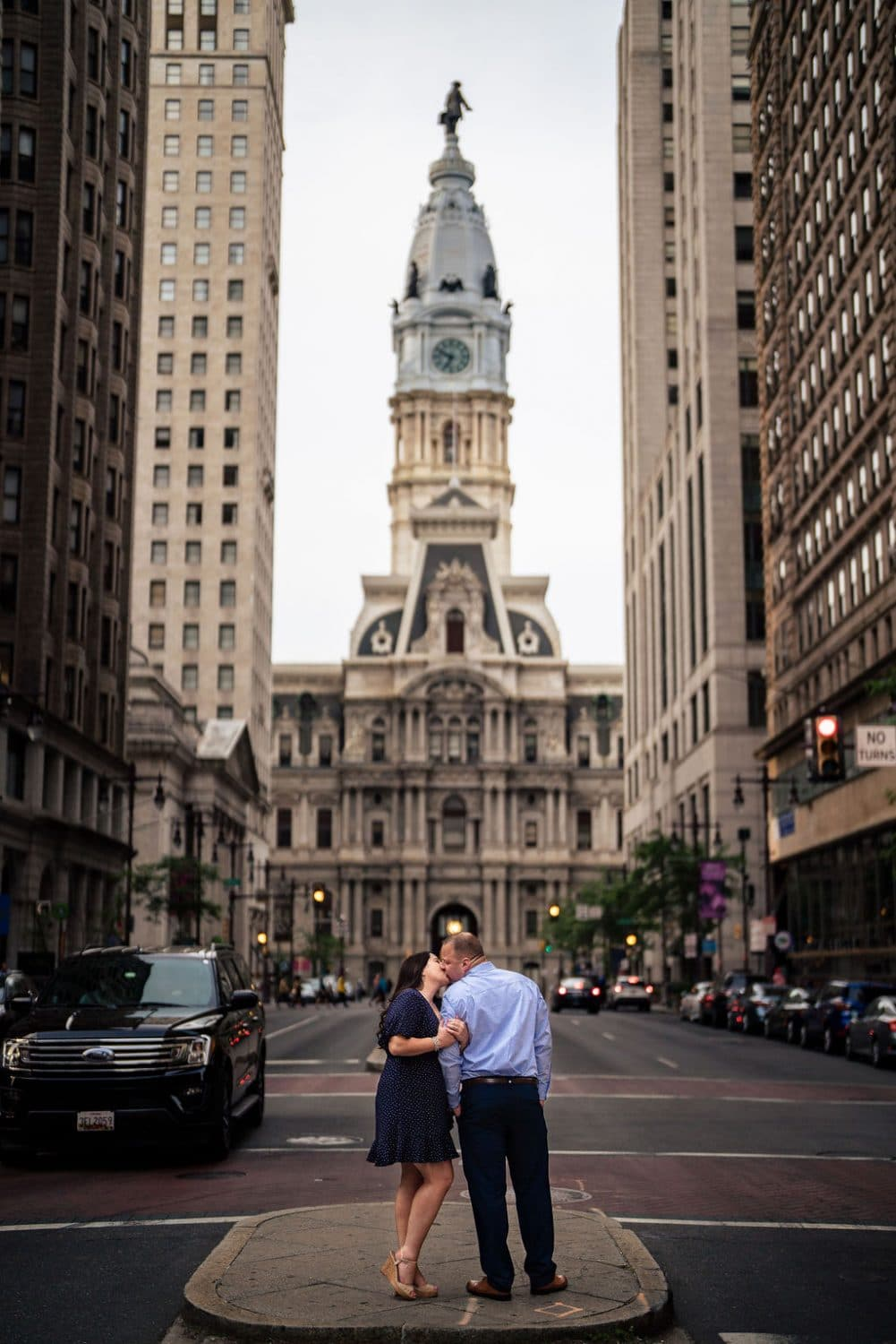 Engaged couple in the middle of the Ave embracing Philadelphia Navy Yard Engagement Session Shot by John Ryan