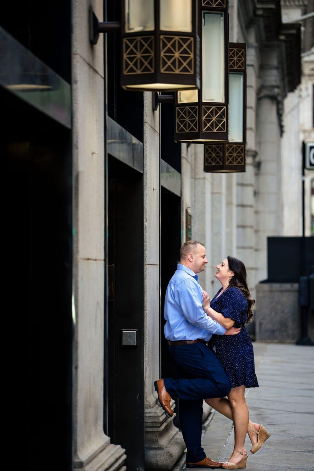 Couple downtown Philly embracing