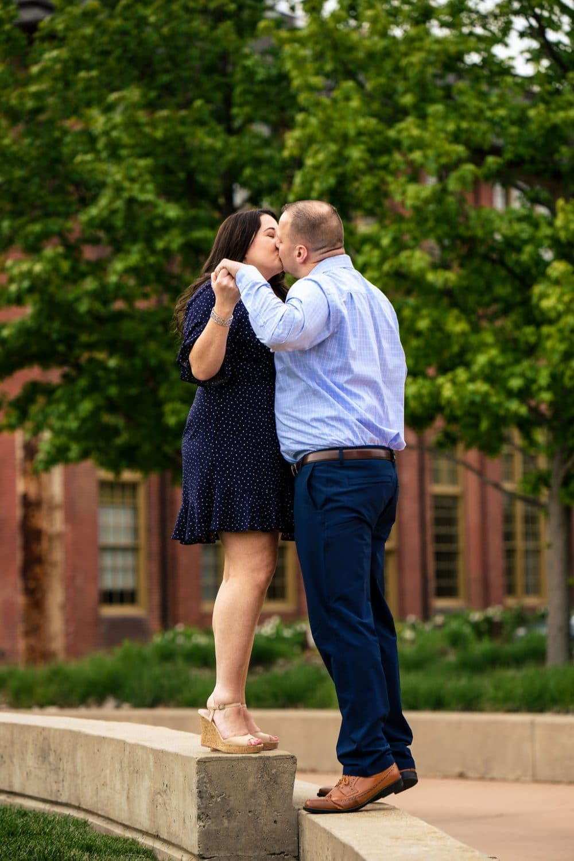 Couple kissing in the Park Philadelphia Navy Yard Engagement Session Shot by John Ryan