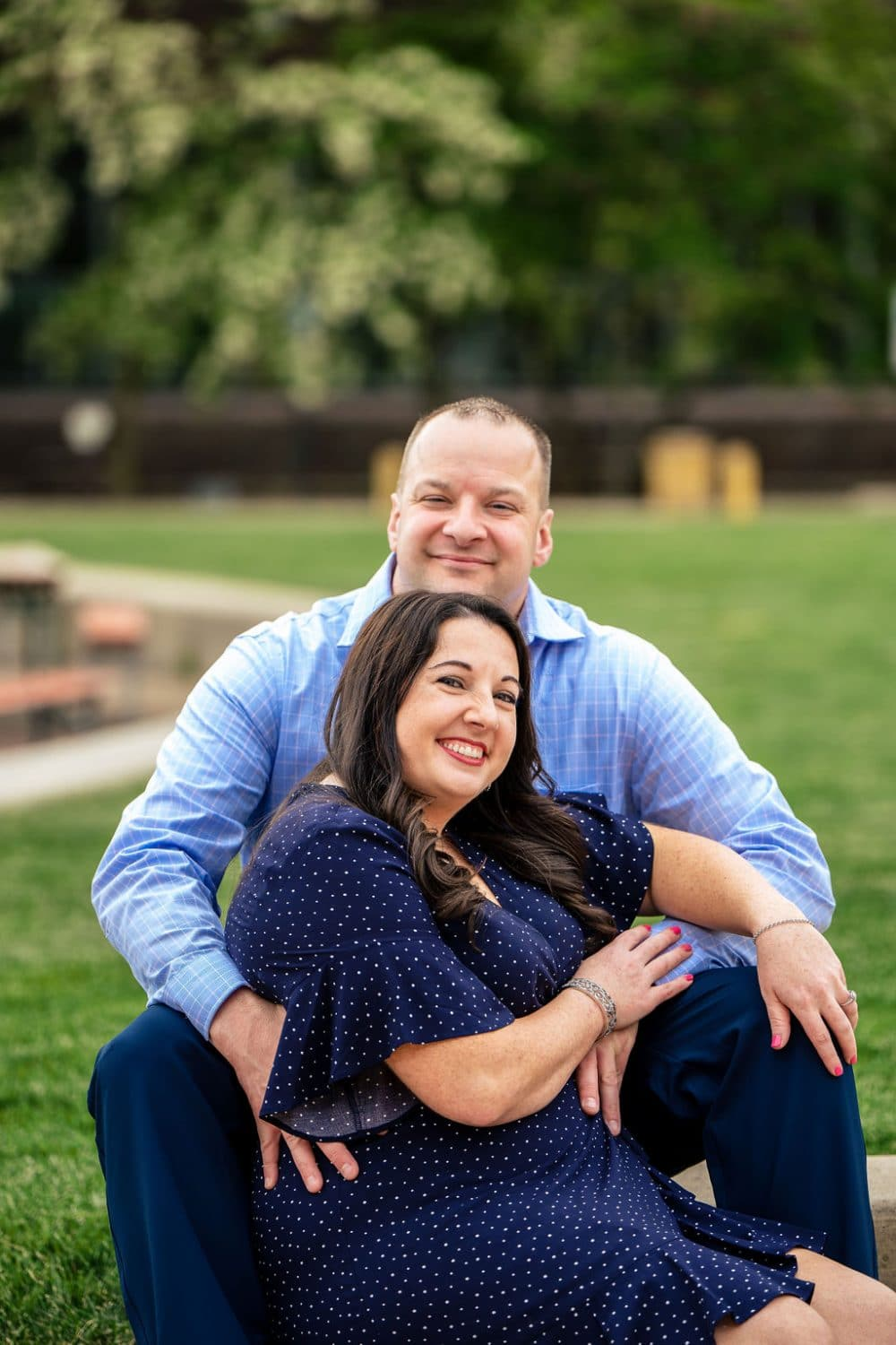 Couple smiling and posing for a photo Philadelphia Navy Yard Engagement Session Shot by John Ryan