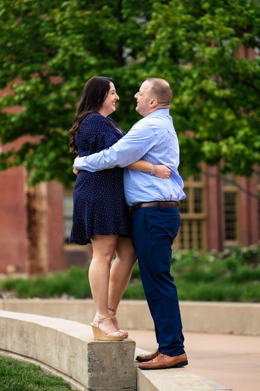 Woman hugging and smiling at her partner at Navy Yard Shot By John Ryan