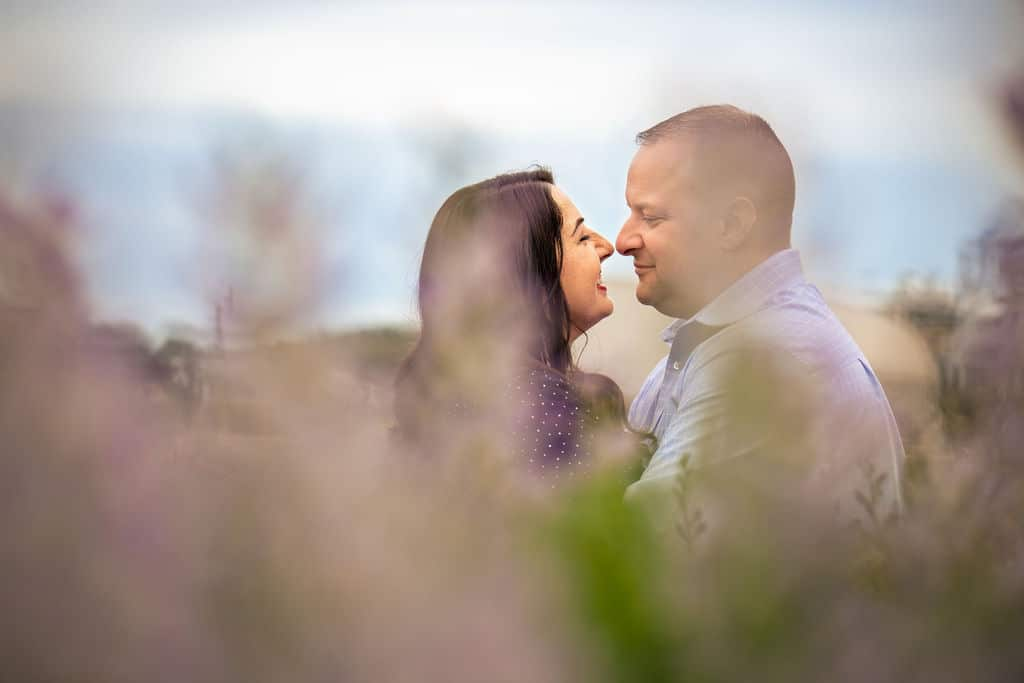 Shot of couple smiling about to kiss each other Philadelphia Navy Yard Engagement Session Shot by John Ryan