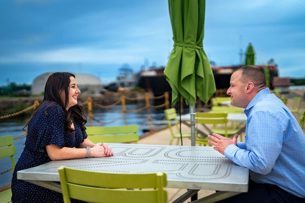 Couple dining laughing at Navy Yard SHOT By John Ryan