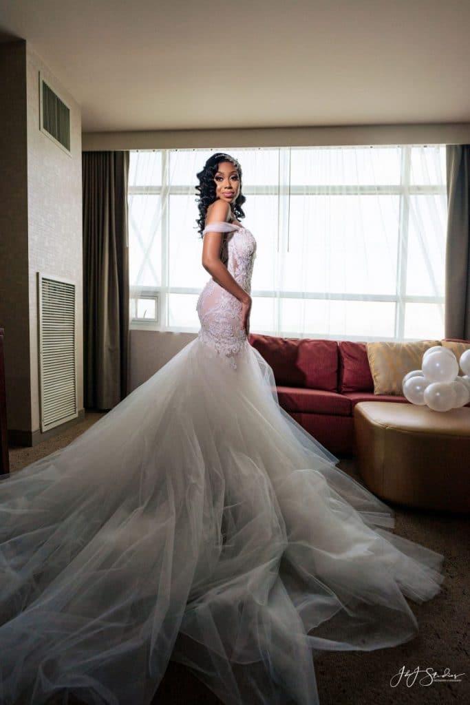 bride in mermaid wedding dress hotel room