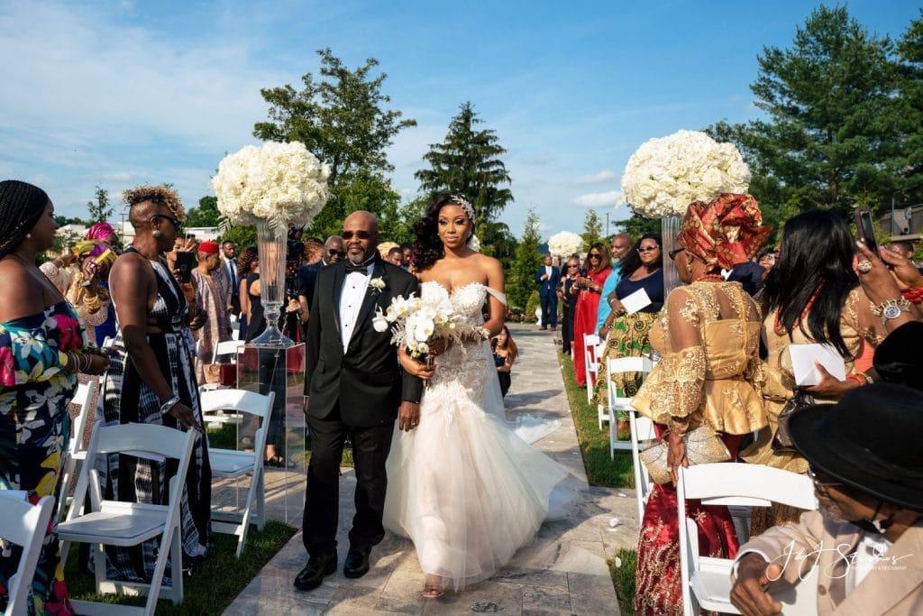 father walking bride down aisle outdoor wedding