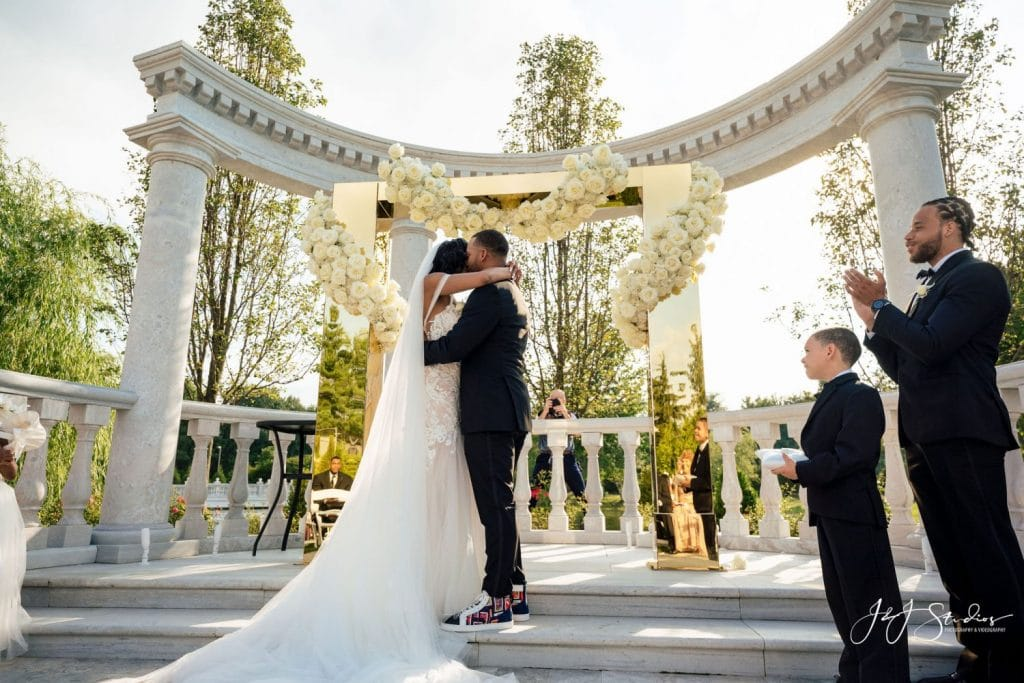 bride and groom first kiss as married couple