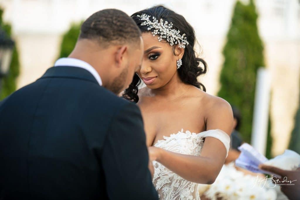 bride looking at groom during ring exchange