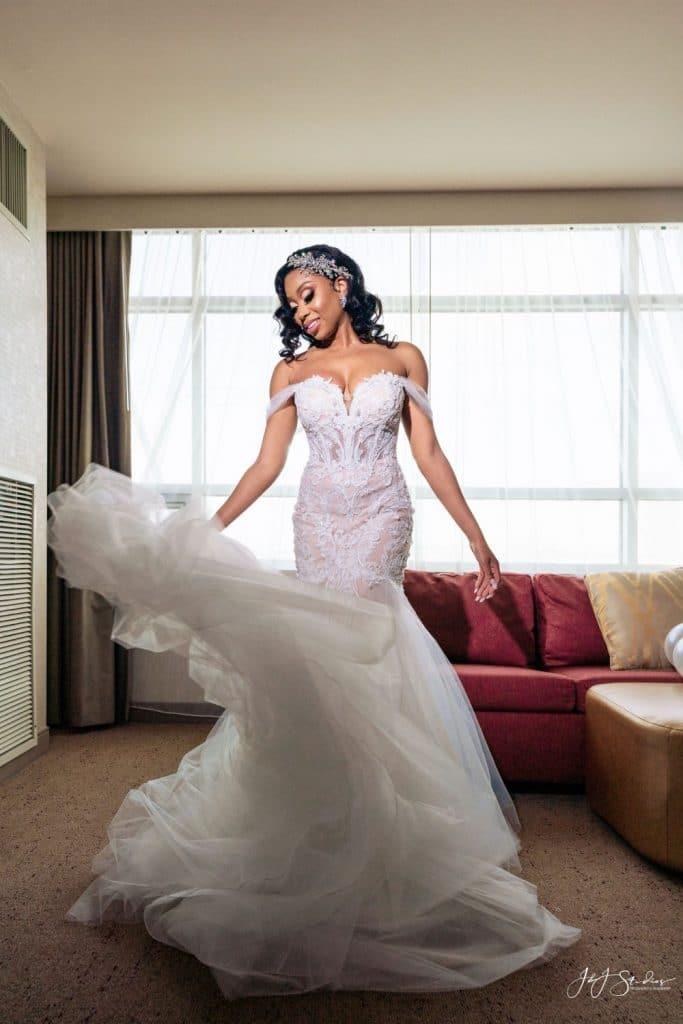 bride in mermaid dress twirling