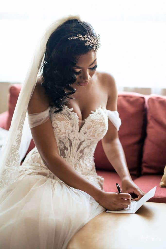 bride writing a card for groom