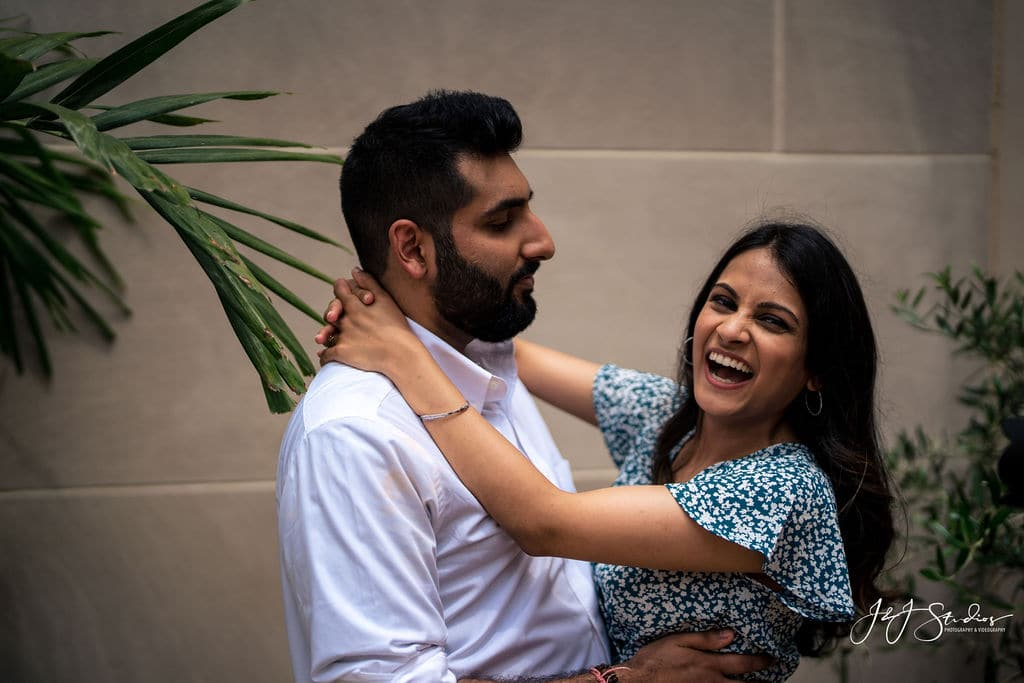 couple laughing in each others arms