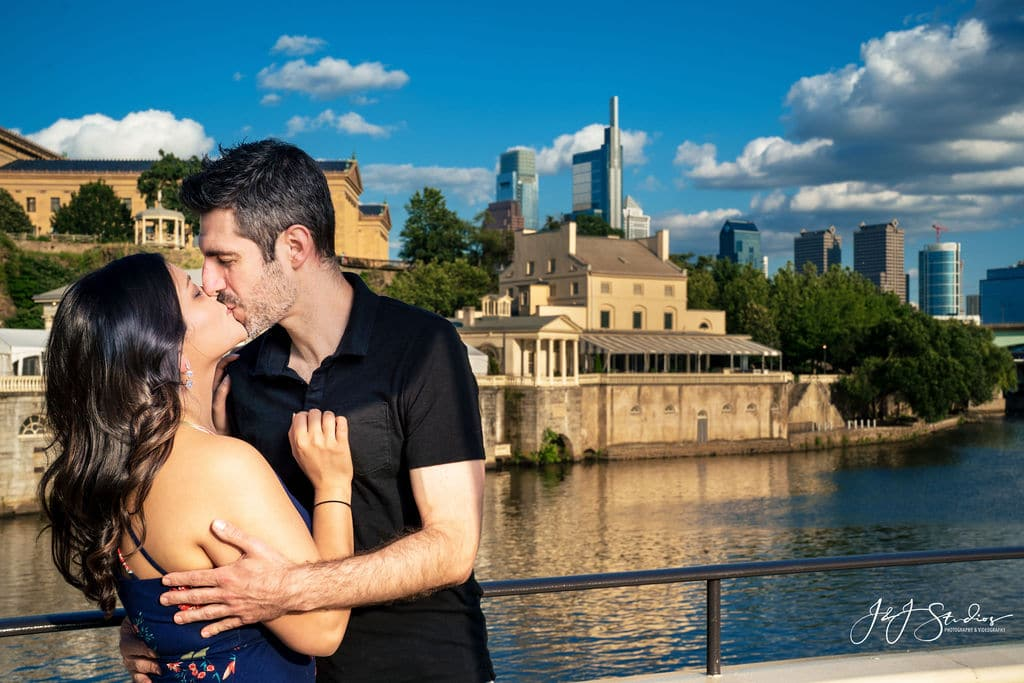 Couple kissing in front of Museum Fairmount Engagement Shot By John Ryan