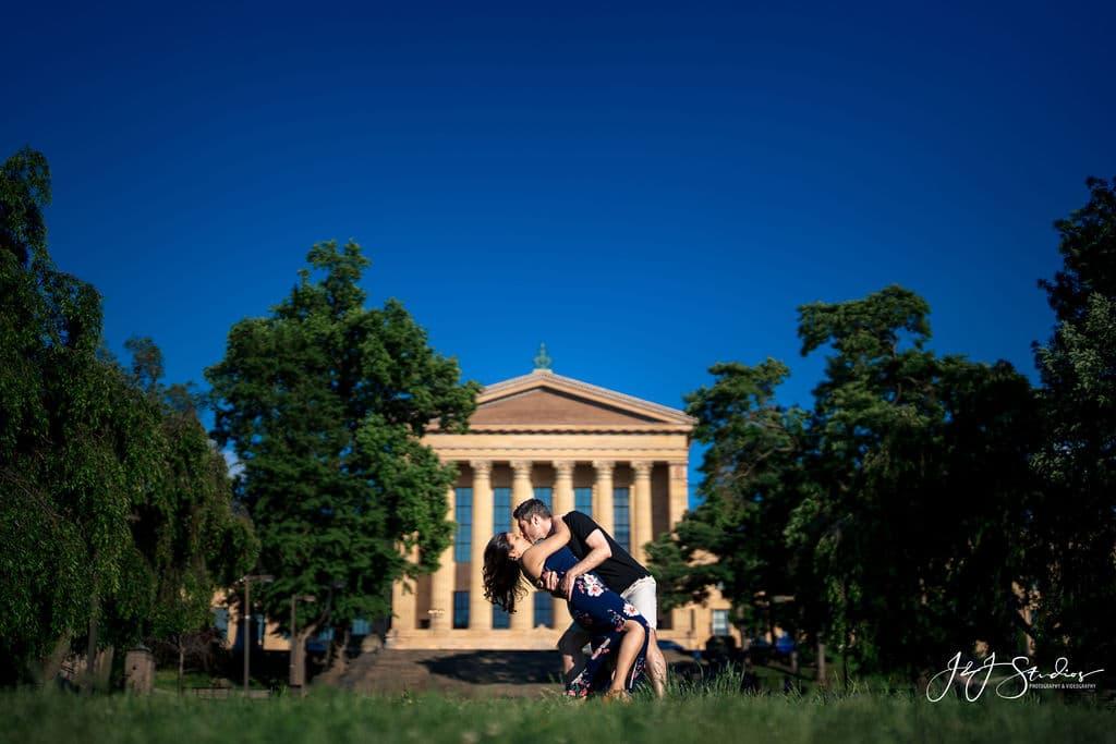 Romantic pose in front of Philly Musuem Fairmount Engagement Shot By John Ryan