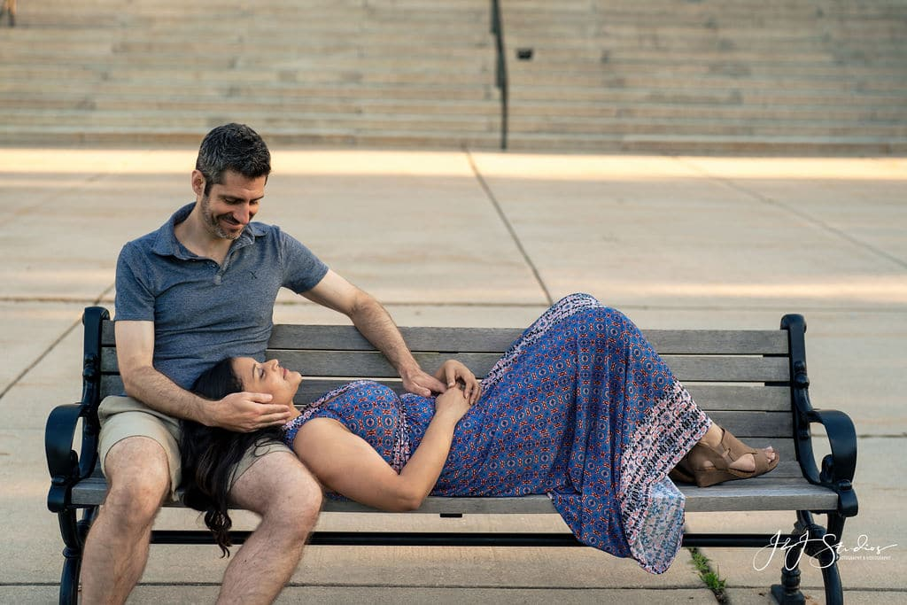 Couple sitting on park bench romantic Fairmount Park Engagement Shot By John Ryan