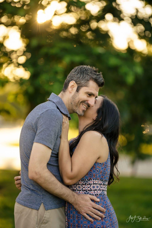 Couple embracing in park Fairmount Engagement Shot By John Ryan