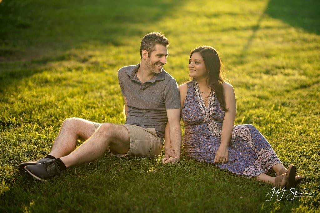 Couple sunbathing in Fairmount Park Fairmount Engagement Shot By John Ryan