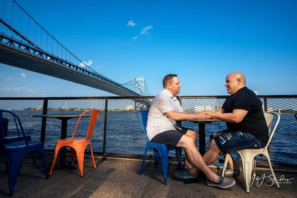 Couple talking on Cherry Street Pier by J&J Studios