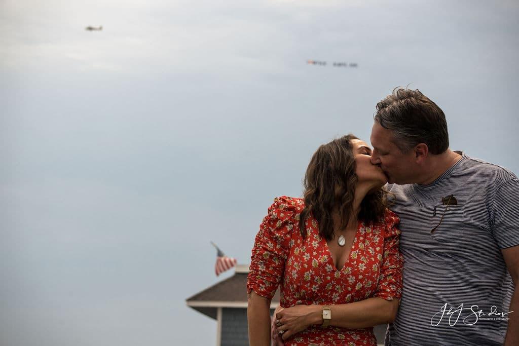 Natalie and Karl kising New Jersey Airplane Proposal Shot By John Ryan