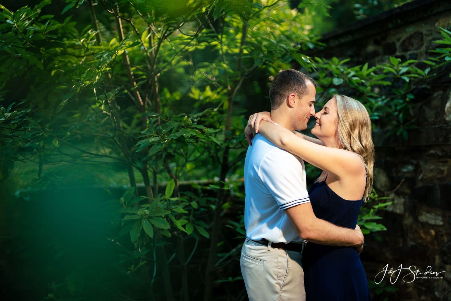 Taryn and Robert in love near Park trees Hunting Hill Mansion Engagement Shot By John Ryan
