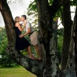 Couple embracing inside of the tree Hunting Hill Mansion Engagement Shot By John Ryan