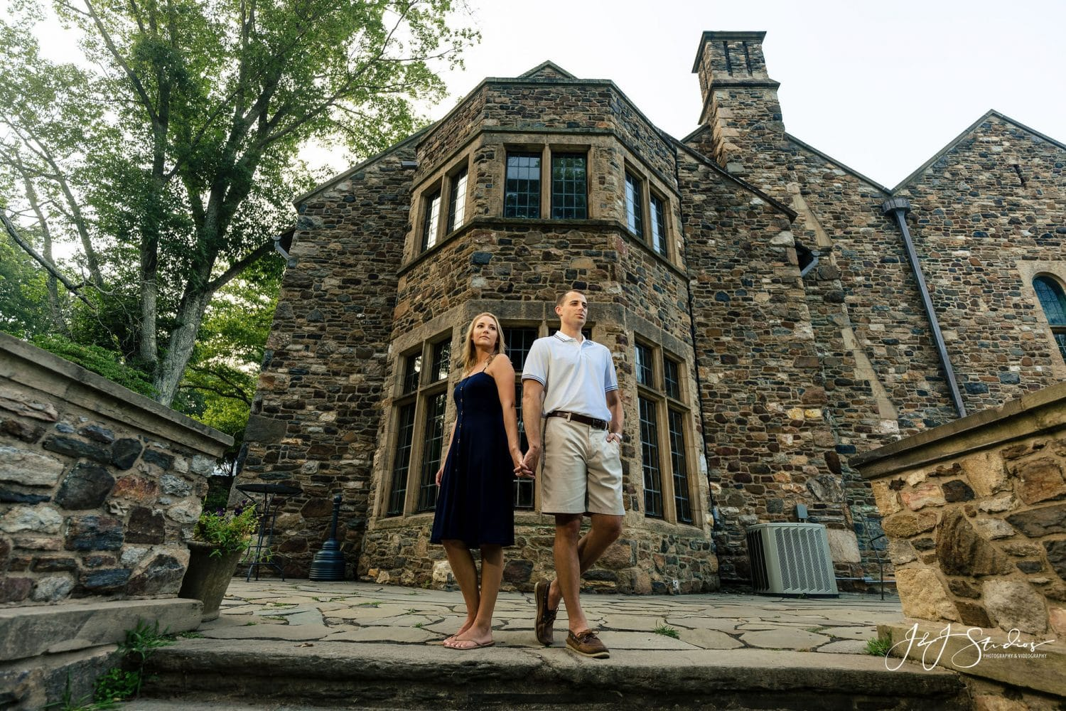 Couple in front of hunting Hill Mansion Hunting Hill Mansion Engagement Shot By John Ryan