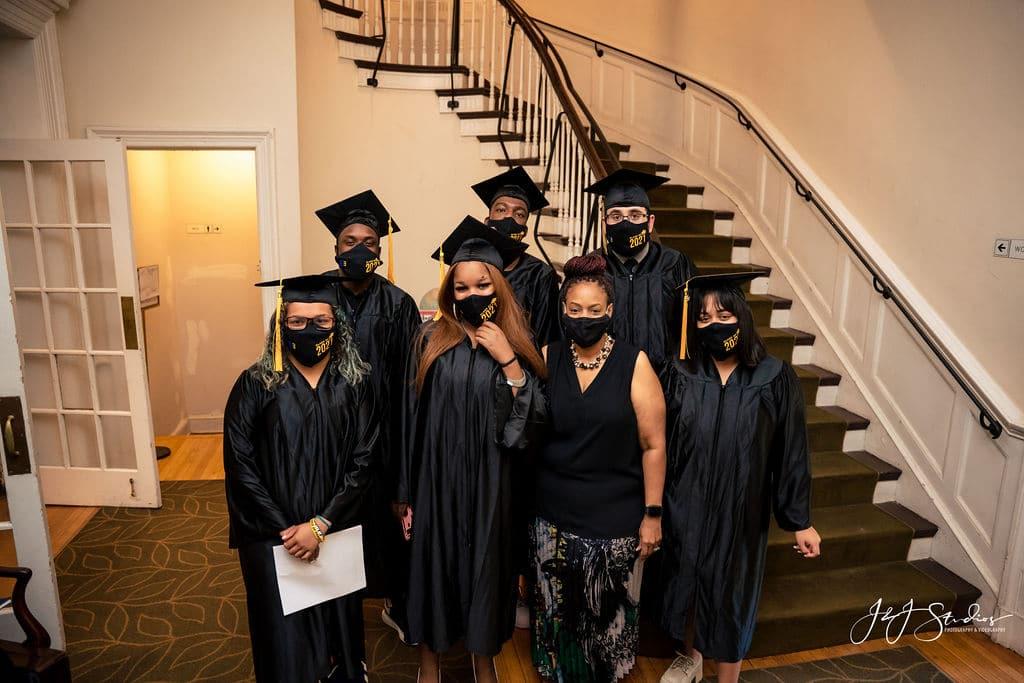 graduates getting ready by J&J Studios