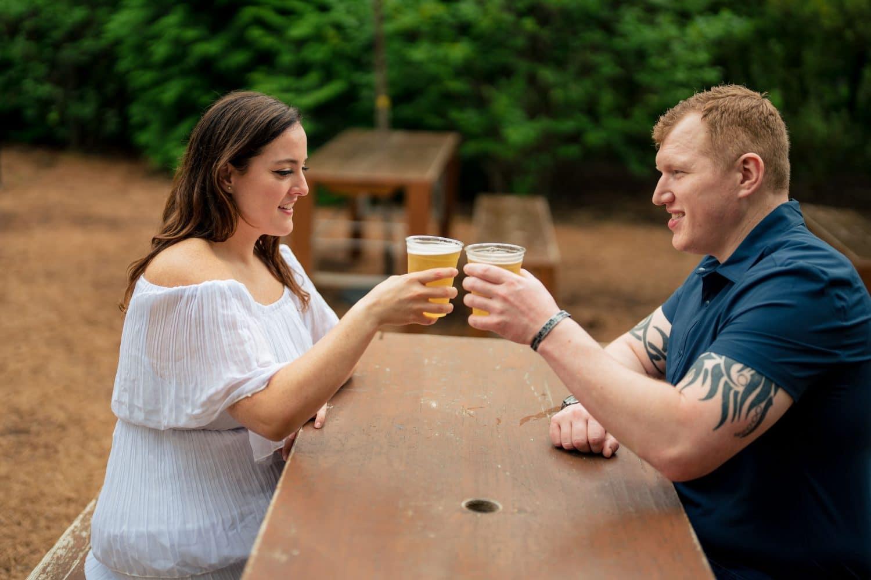 Couple grabbing a drink by J&J Studios