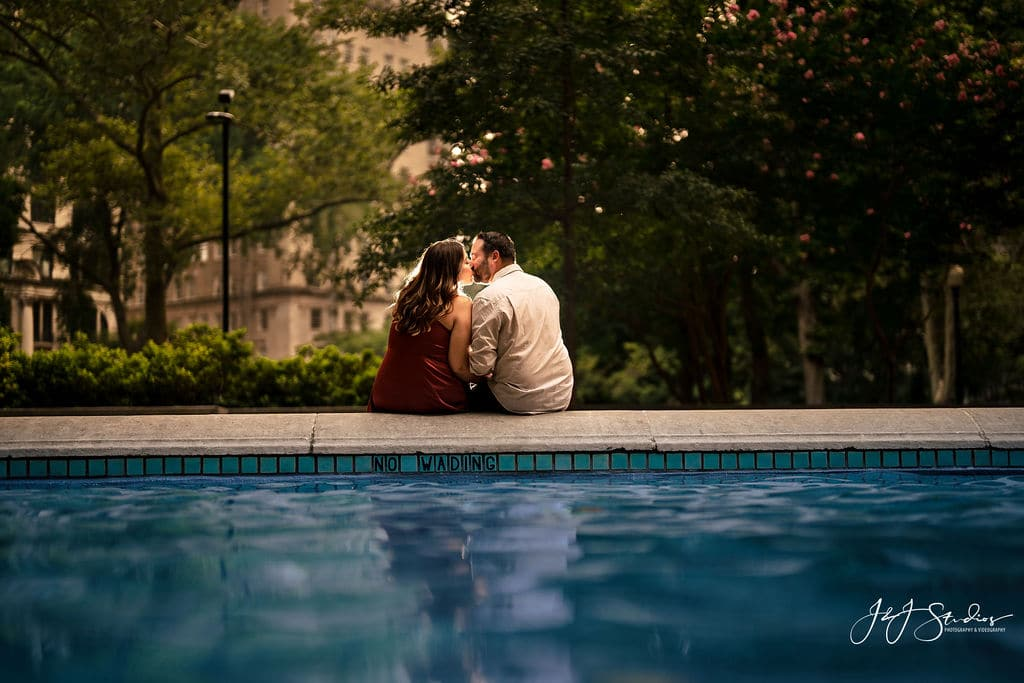 Couple sitting by water at Rittenhouse