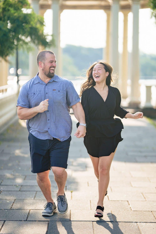 Couple running by J&J Studios