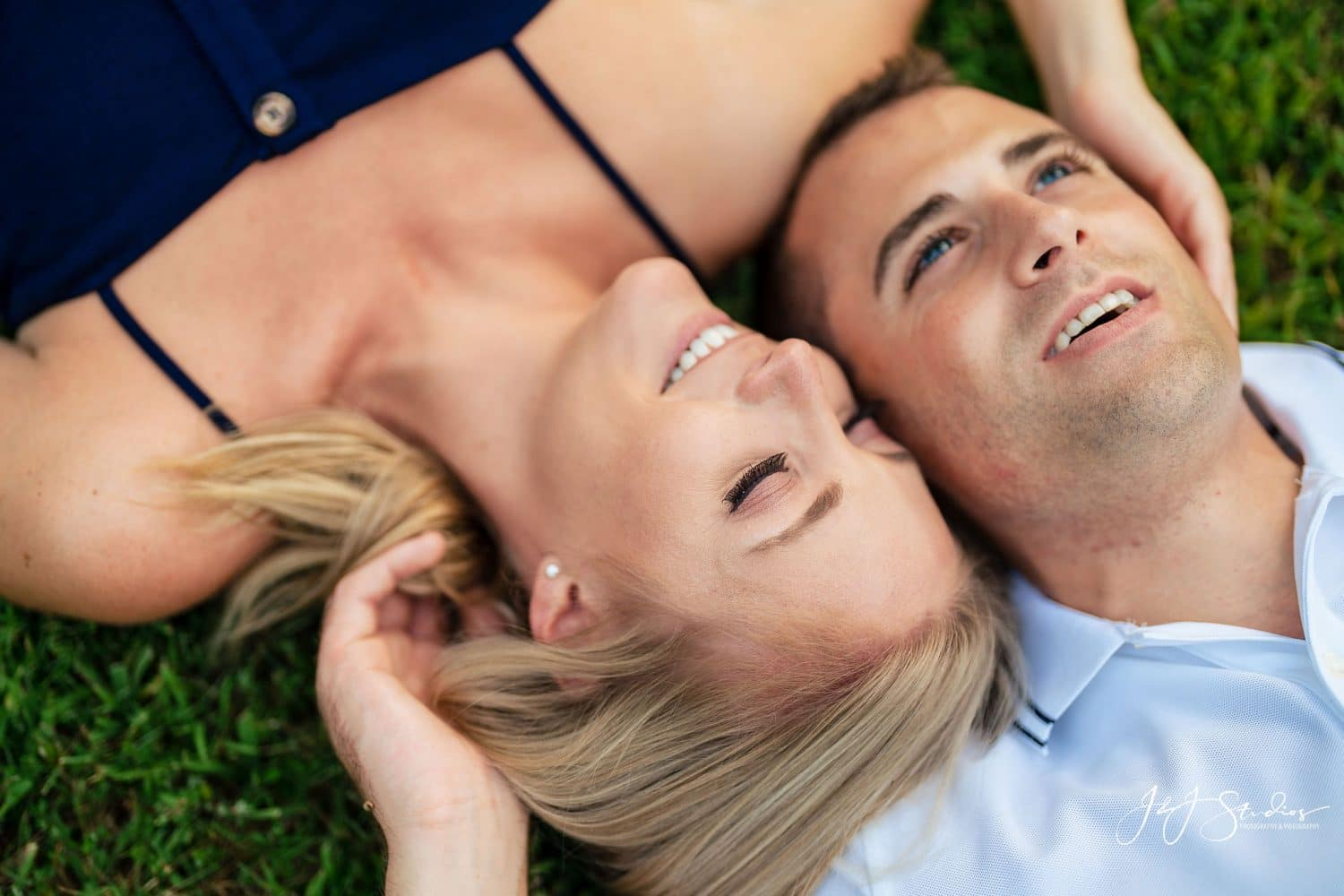 Laying in the grass by J&J Studios