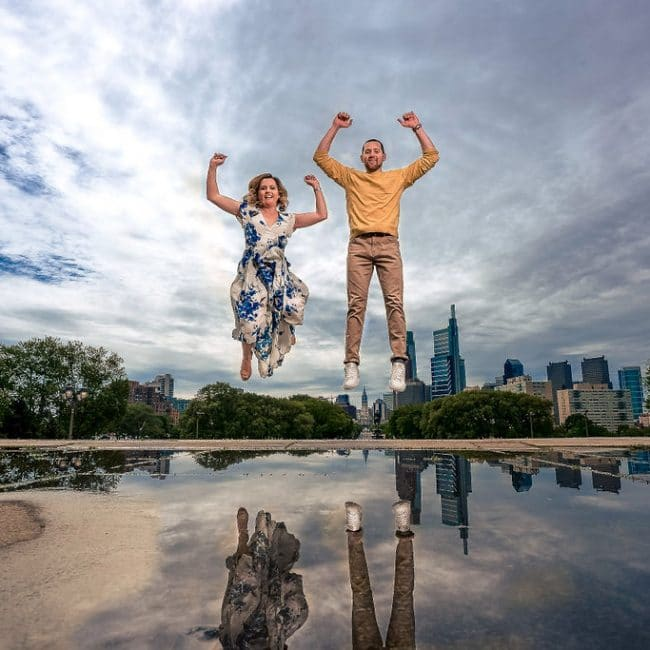 Couple jumping for their engagement photo shoot