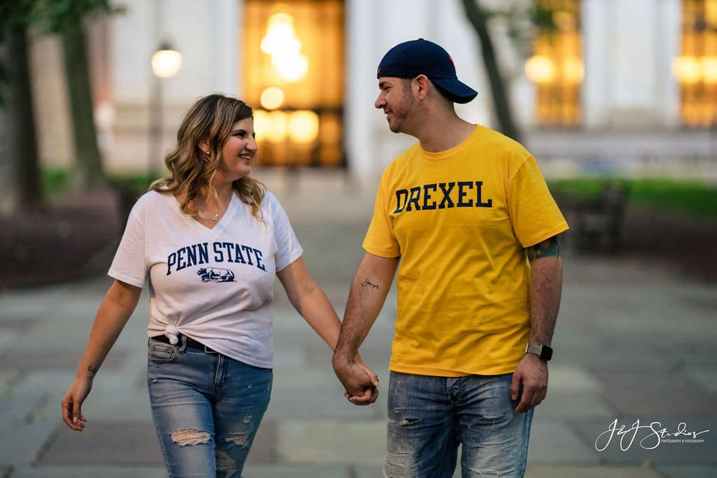 couple holding hands in college shirts