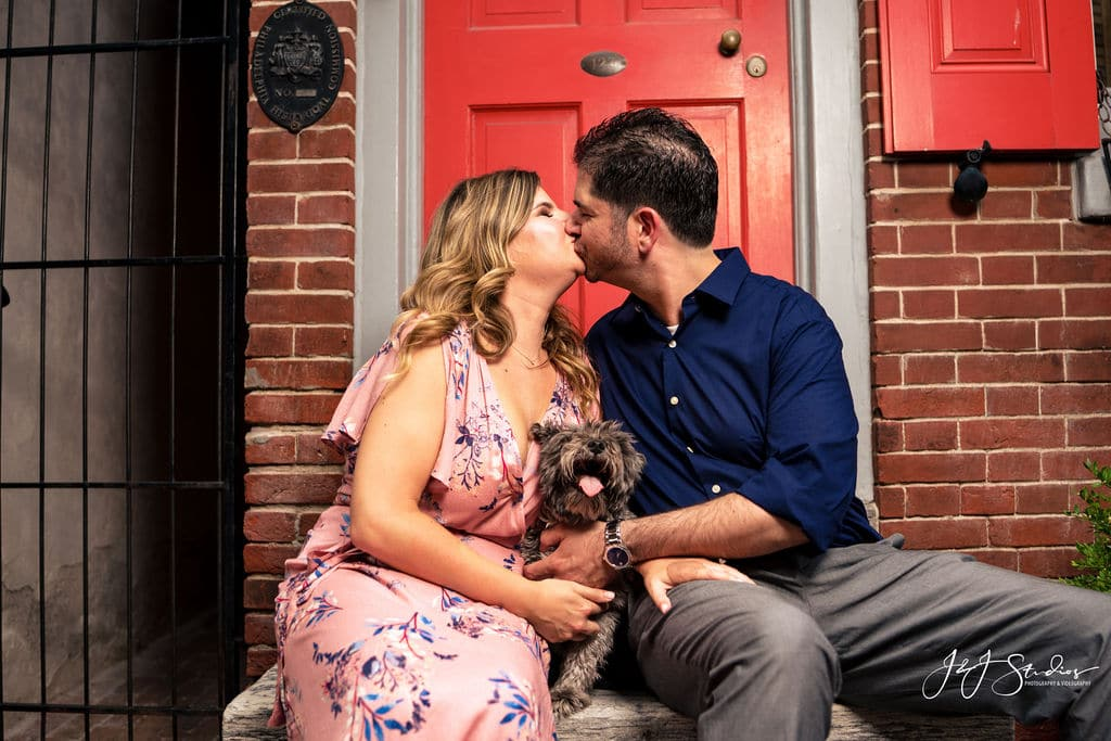 couple sitting on steps kissing