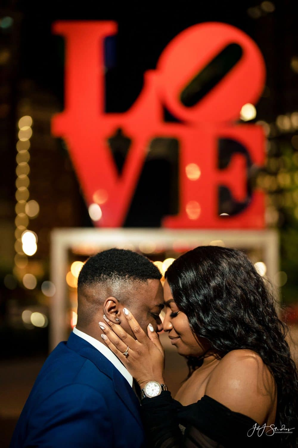 Passionate kiss in front of Love Park Statue shot by John Ryan