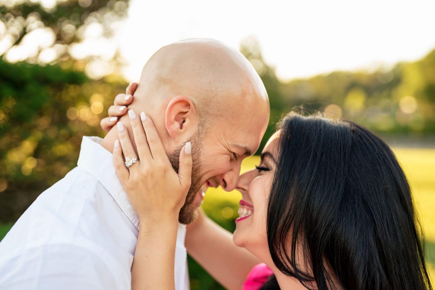 couple heads together smiling engagement