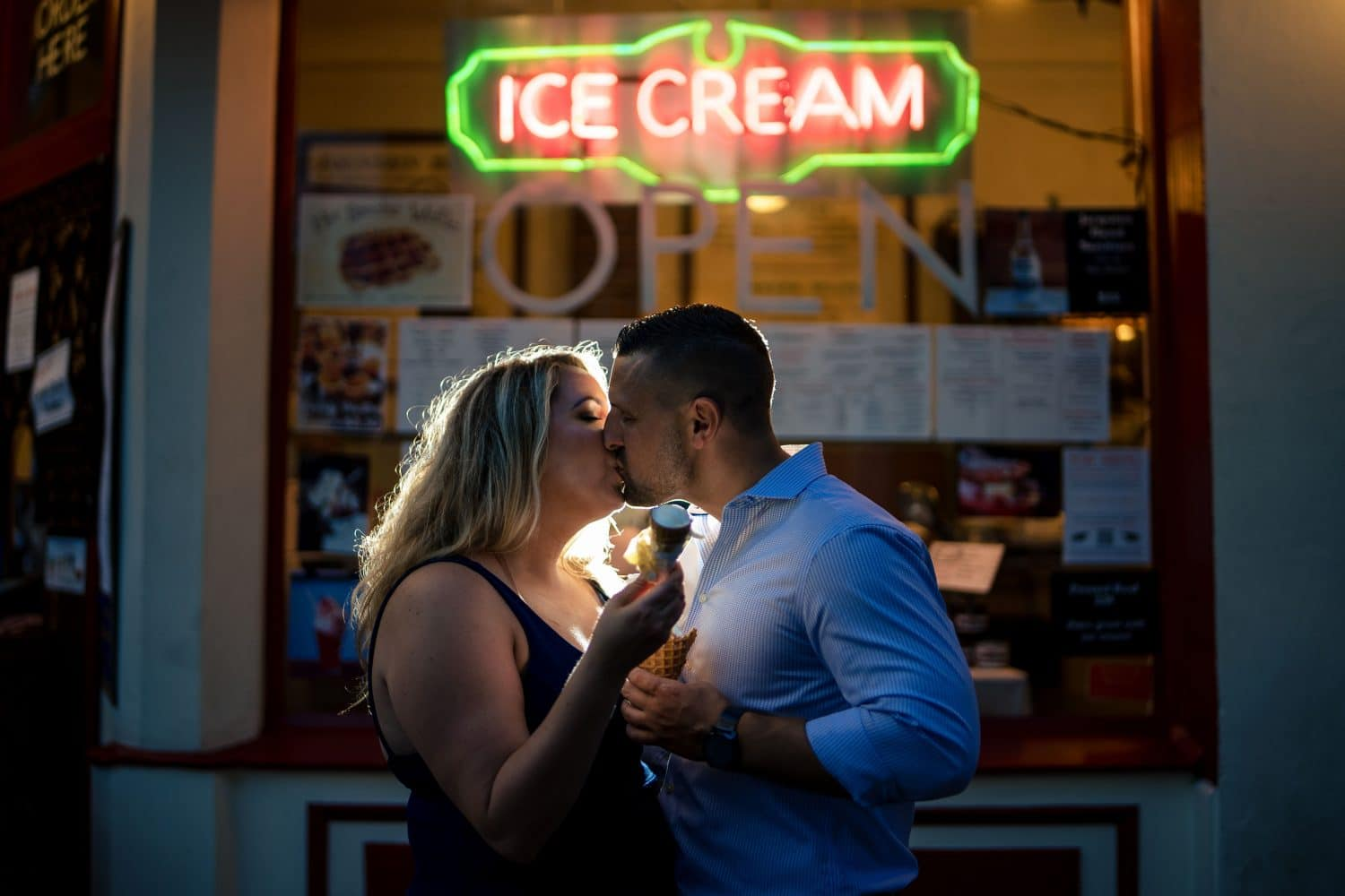 Couple standing over the famous Ice Cream sign in Philly