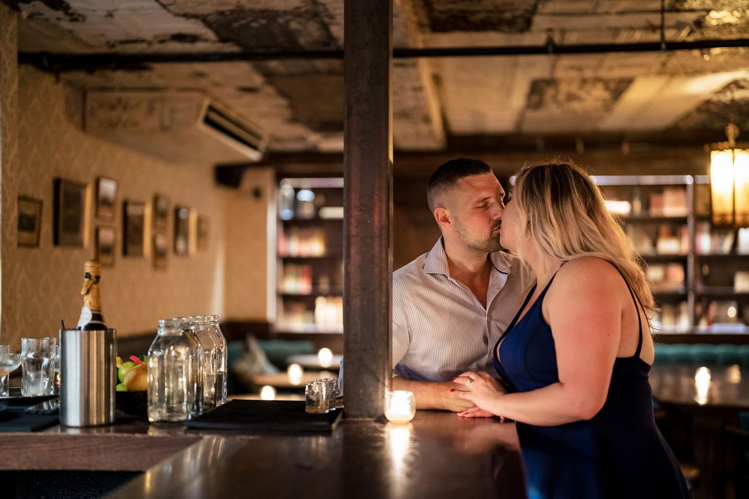 Couple kissing at the wine cellar in Philly Philadelphia Engagement Shot By John Ryan