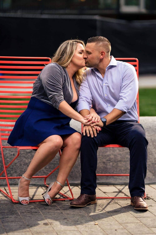 Couple sitting on the bench at Love Park Philadelphia Engagement Shot By John Ryan