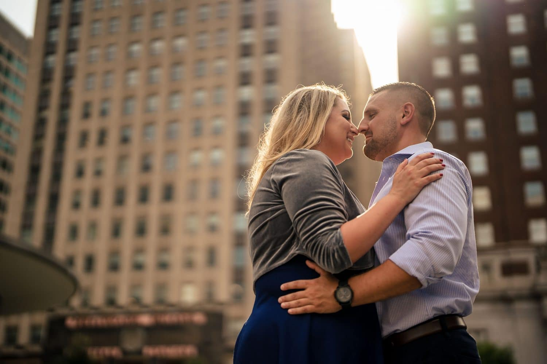 Couple embracing at Love Park Philadelphia Engagement Shot By John Ryan