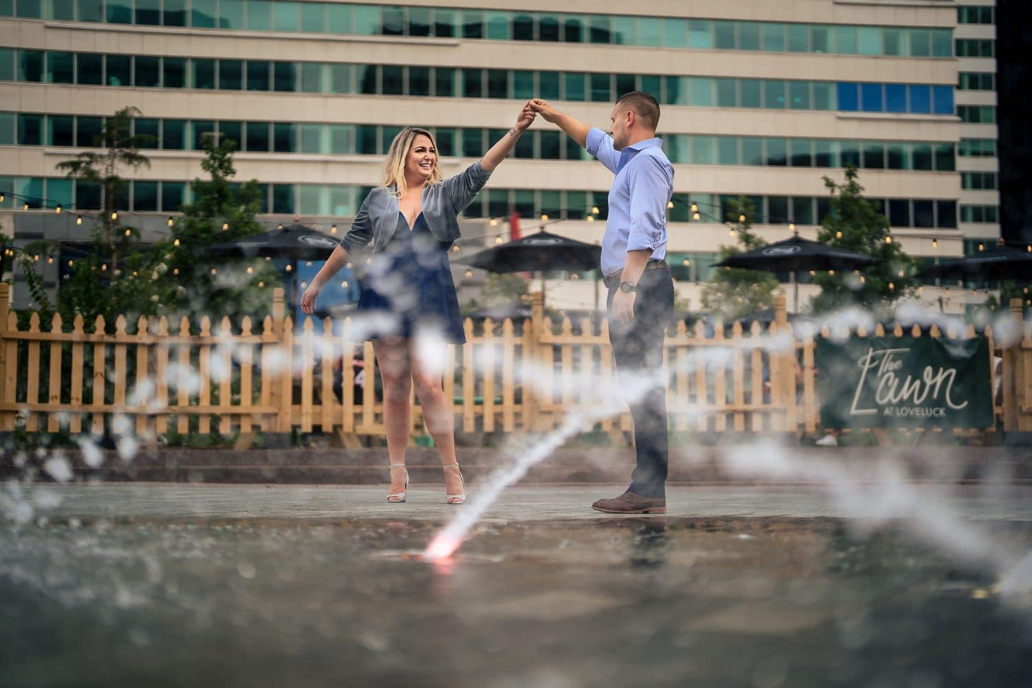 Playing at the Love Park water fountain Philadelphia Engagement Shot By John Ryan