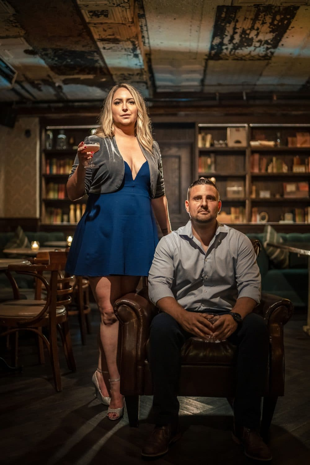 Woman standing by her man at Philly wine cellar Shot By John Ryan