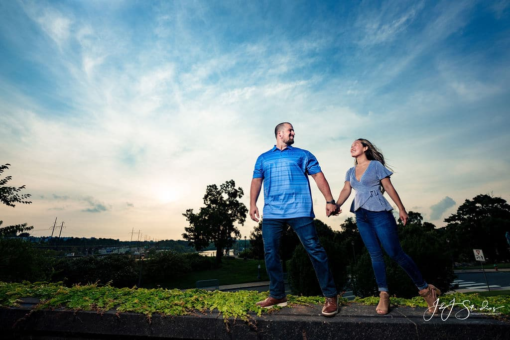 Rich and Jackie walking through the Fairmount in Philly Philadelphia Museum of Art and Fairmount Waterworks Engagement Shot By John Ryan