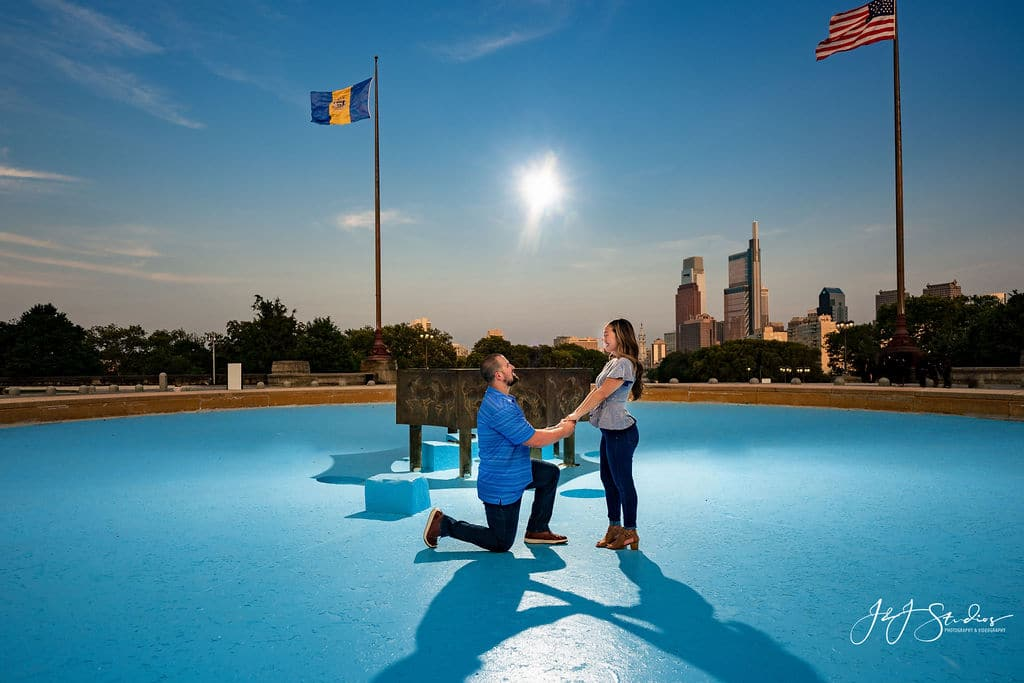 Man proposing to woman during Philly engagement session Shot By John Ryan