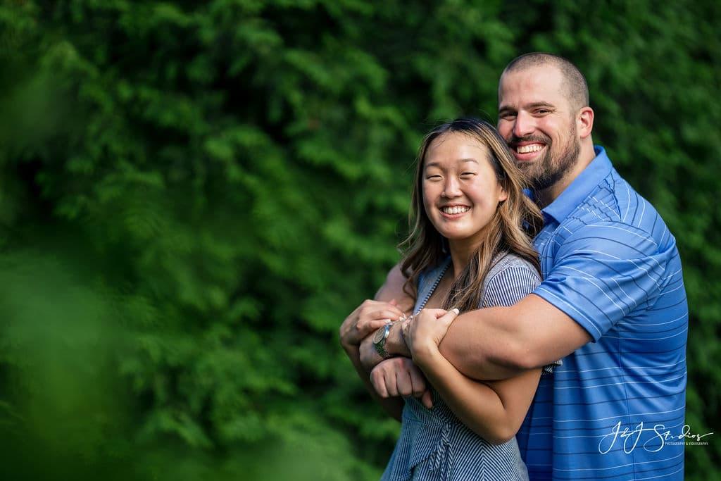 Happy couple smiling at the Fairmount Philadelphia Museum of Art and Fairmount Waterworks Engagement Shot By John Ryan