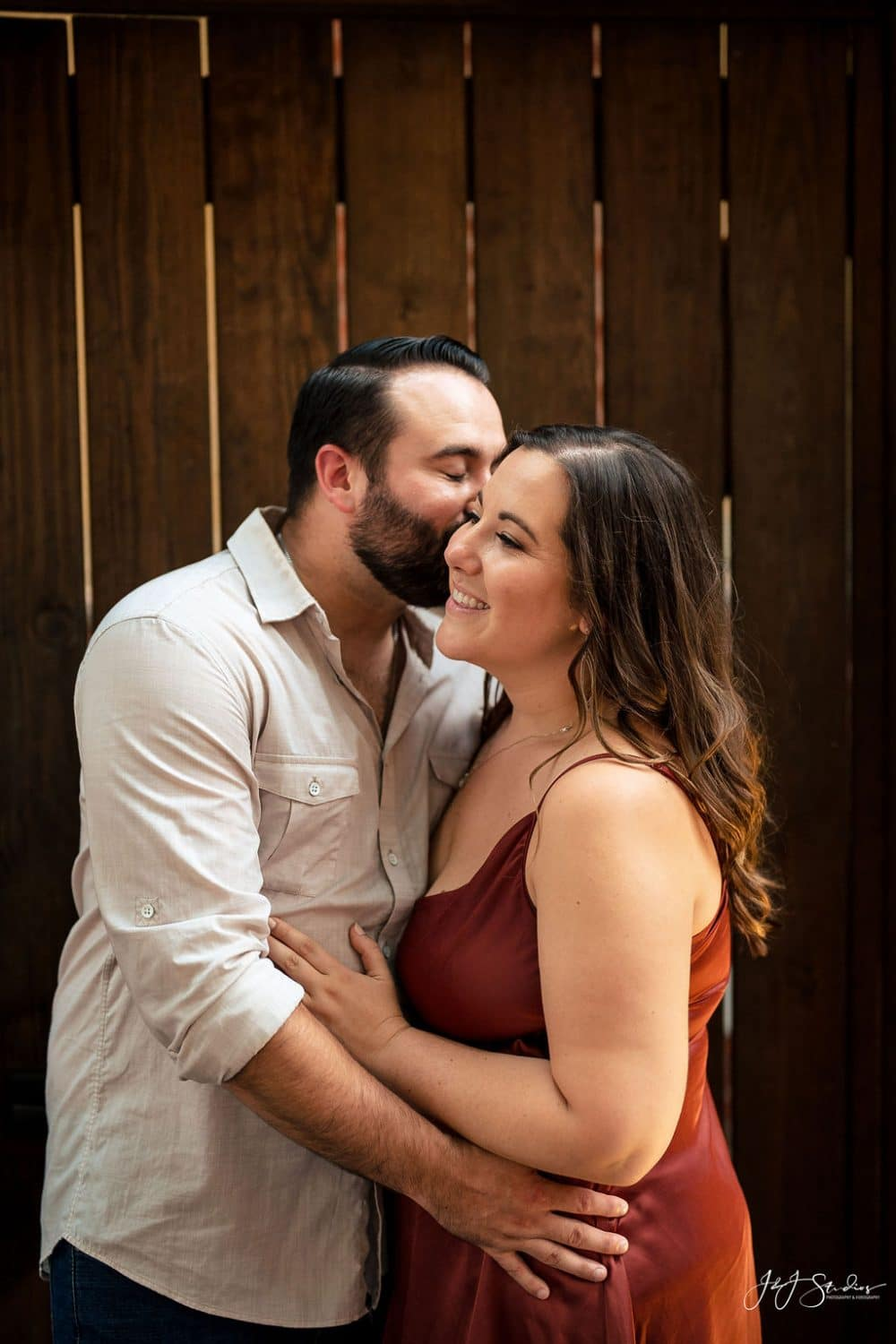 James kissing his fiance during photoshoot Rittenhouse Square and Addison Street Engagement Shot By John Ryan